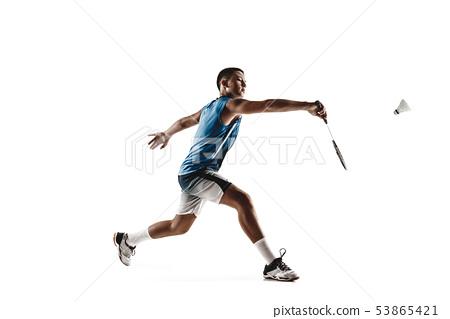 Little boy playing badminton isolated on white studio background 53865421