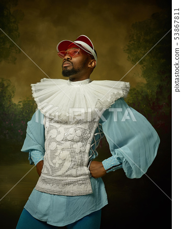 Young man as a medieval knight on dark background 53867811