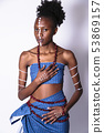 African girl with face art put her hand on heart 53869157