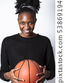 African woman with basket ball looking at camera 53869194