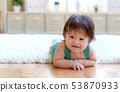 Happy baby boy lying down 53870933