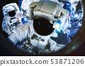 Astronauts near the Earth Planet 53871206