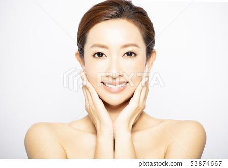 closeup young woman face with makeup and teeth 53874667