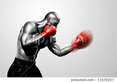 Strong boxer throwing a hook 53876057