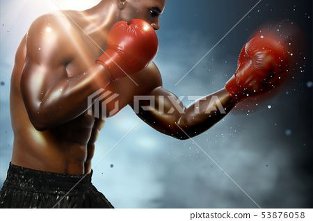 Strong boxer throwing a hook 53876058