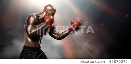 Strong boxer throwing a hook 53876072