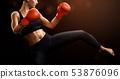 Female boxer kicks high 53876096