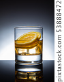 Glass of cocktail with ice-cubes and lemon, isolated 53888472