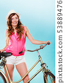 Woman with bike. Summer fashion and recreation. 53889476