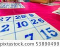Bingo boards are on the table at the festival 53890499