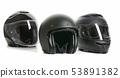 Three black motorcyle helmets. 53891382