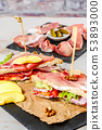 sandwiches with salad, tomatoes, ham and onions 53893000
