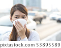 City air pollution concept. Woman wearing N95 mask 53895589