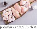 Raw chicken meat on wooden background 53897634