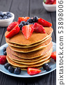 Tasty pancakes with blueberry and strawberry 53898006