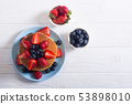 Tasty pancakes with blueberry and strawberry 53898010