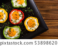 Yellow , red and green pepper with fried eggs 53898620
