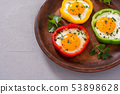 Yellow , red and green pepper with fried eggs 53898628