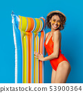 Happy african lady in swimwear smiling with colorful swim mattress 53900364