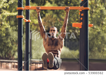 Afro Sporty Man Doing L-Sit On Horizontal Bar 53900382