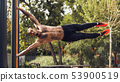 Strong Man Practicing Human Flag Exercise, Gripping Vertical Bar 53900519