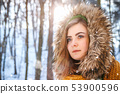 Young woman winter portrait. Close-up portrait of happy girl. Expressing positivity, true brightful 53900596