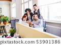Group of young businesspeople working in office, start-up concept. 53901386