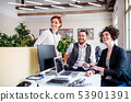 Group of young businesspeople using laptop in office, start-up concept. 53901391