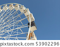 Close-up big white modern ferris wheel against clear blue sky on background in Kiev city center. One 53902296