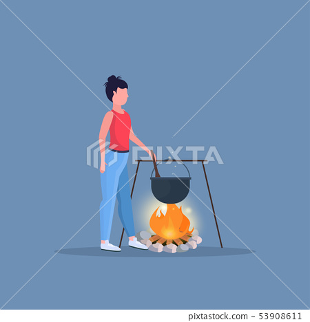 woman hiker cooking meals girl preparing food in bowler boiling pot at campfire hiking camping 53908611