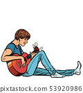 Young teenager man plays acoustic guitar 53920986