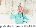 Girl has fun throwing snowballs 53924830
