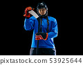 Young female hockey player with the stick isolated on black background 53925644