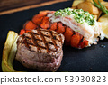 surf and turf on black stone plate 53930823