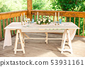 Decorated table for dinner for two person, with plates knife, fork, cheese, wine, wine glasses and 53931161