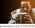 Portrait close-up, American football player, bearded in helmet. Concept American football 53932496
