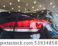 Close up of rear lights detail of modern luxury car with projector lens for low and high beam. Front 53934858