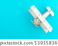 Wood airplane toy on colorful color paper 53935836