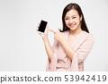 Portrait of beautiful Asian wowan showing mobile 53942419