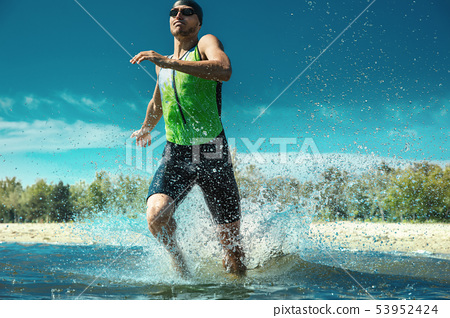 Professional triathlete swimming in river's open water 53952424
