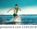 Professional triathlete swimming in river's open water 53952638