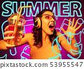 Beautiful girl isolated on studio background in neon light 53955547