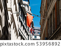 Low angle view of Chinese and UK flag in London 53956892