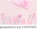 Three unicorn makeup brushes on silver violet 53976365