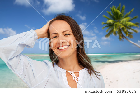 happy smiling woman on summer beach 53983638