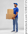 happy indian delivery man with parcel boxes 53983725