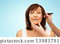 senior woman and hands with cosmetic marker 53983791