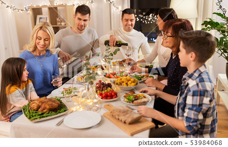 happy family having dinner party at home 53984068