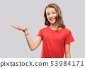 smiling teenage girl holding empty hand 53984171