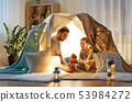 happy family playing with toy in kids tent at home 53984272